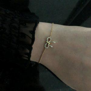 18ct yellow gold diamond set bow bracelet