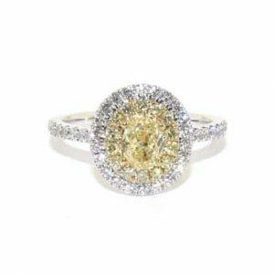 18ct white & yellow gold 0.59ct oval diamond ring