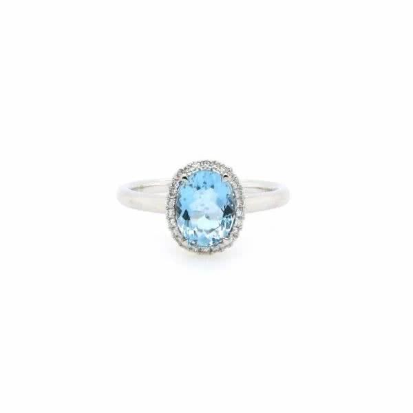 18ct white gold 1.24ct oval aquamarine and diamond halo ring