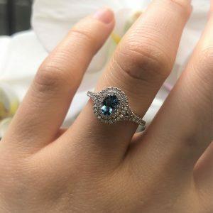 18ct white gold 0.37ct oval santa maria aquamarine & diamond halo ring