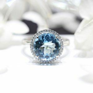 18ct white gold 4.73ct Aquamarine and diamond halo ring