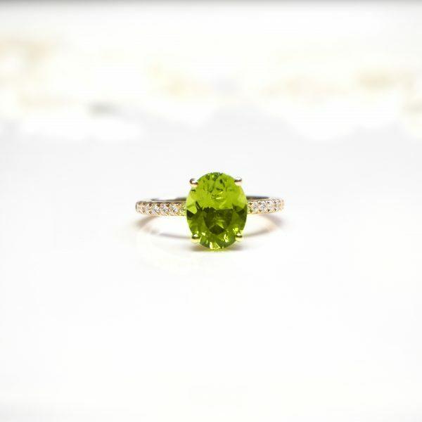 18ct yellow gold 2.74ct oval peridot and diamond ring