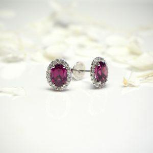 18ct white gold oval garnet and diamond stud earrings